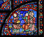 Stephen makes a speech before the Sanhedrin and sees a vision of the son of God standing next to God in heaven. A beam of light from a cloud shines on his face. Section of the vision of St Stephen, 1220-25, from the Life of St Stephen and transferral of his relics window in the ambulatory of Chartres Cathedral, Eure-et-Loir, France. This window, unusually dominantly red in colour, tells the story of the life of St Stephen, the first Christian martyr, who died c. 36 AD and whose relics are held at Chartres. It is situated in the chapel dedicated to martyrs. Chartres cathedral was built 1194-1250 and is a fine example of Gothic architecture. Most of its windows date from 1205-40 although a few earlier 12th century examples are also intact. It was declared a UNESCO World Heritage Site in 1979. Picture by Manuel Cohen