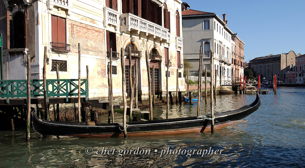 Gondola moored along the Grand Canal in Venice, Italy. April 2002.