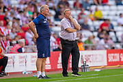 AFC Wimbledon manager Wally Downes and assistant manager Glyn Hodges (left) during the EFL Sky Bet League 1 match between Sunderland and AFC Wimbledon at the Stadium Of Light, Sunderland, England on 24 August 2019.