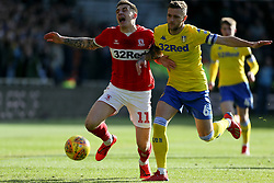 Middlesbrough's Jordan Hugill (left) and Leeds United's Liam Cooper during the Sky Bet Championship match at The Riverside Stadium, Middlesbrough.