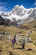 """Trekking under Nevado Jirishanca (""""Icy Beak of the Hummingbird"""" 6094 m), downstream from Lake Mitucocha. Day 2 of 9 days trekking around the Cordillera Huayhuash in the Andes Mountains, Peru, South America."""