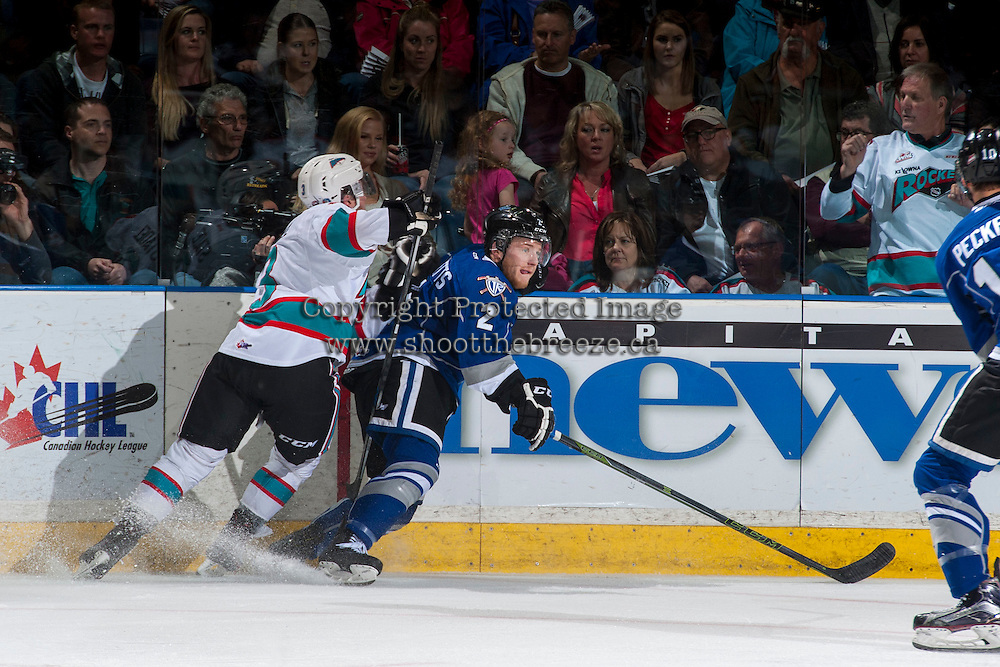 KELOWNA, CANADA - APRIL 14: Joe Hicketts #2 of Victoria Royals stops with the puck while being checked by a player of the Kelowna Rockets during second period on April 14, 2016 at Prospera Place in Kelowna, British Columbia, Canada.  (Photo by Marissa Baecker/Shoot the Breeze)  *** Local Caption *** Joe Hicketts;