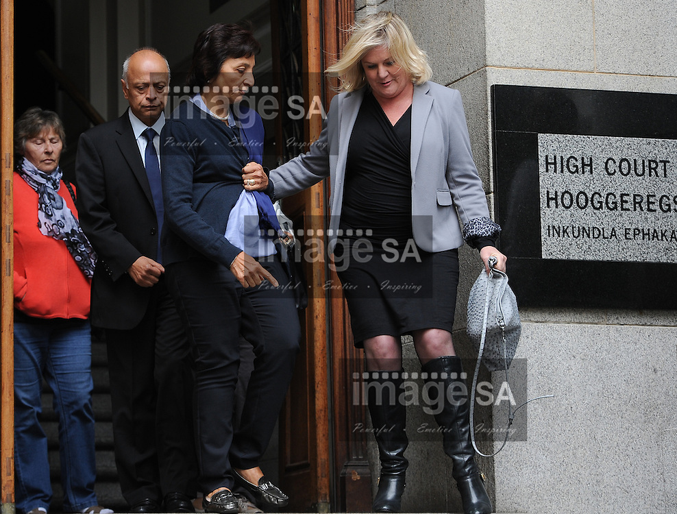 CAPE TOWN, SOUTH AFRICA - Thursday 8 October 2014, Mrs Snila Dewani, mother of Shrien Dewani and her husband Prakash (back) leaves court during Day 3 of the Shrien Dewani trial at the Cape High Court before Judge Jeanette Traverso. Dewani is caused of hiring hit men to murder his wife, Anni. Anni Ninna Dewani (n&eacute;e Hindocha; 12 March 1982 &ndash; 13 November 2010) was a Swedish woman who, while on her honeymoon in South Africa, was kidnapped and then murdered in Gugulethu township near Cape Town on 13 November 2010 (wikipedia).<br />