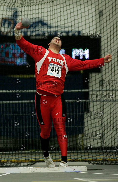 (Windsor, Ontario---13 March 2010) Umar Khan of York University Yoemen   competes in the men's shot put at the 2010 Canadian Interuniversity Sport Track and Field Championships at the St. Denis Center. Photograph copyright Julie Robins/Mundo Sport Images. www.mundosportimages.com