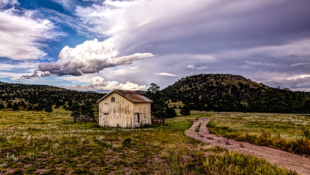 A Little Barn At The Beginning Of A Trailhead Into The Rocky Mountains.