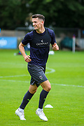 AFC Wimbledon midfielder Callum Reilly warms up during the Pre-Season Friendly match between Hampton & Richmond and AFC Wimbledon at Beveree Stadium, Richmond Upon Thames, United Kingdom on 27 July 2019.