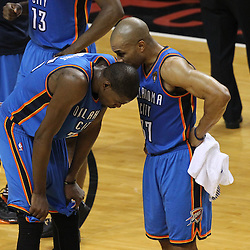 Jun 21, 2012; Miami, FL, USA; Oklahoma City Thunder point guard Derek Fisher (37) talks to Oklahoma City Thunder small forward Kevin Durant (35) during the fourth quarter in game five in the 2012 NBA Finals against the Miami Heat at the American Airlines Arena. Mandatory Credit: Derick E. Hingle-US PRESSWIRE