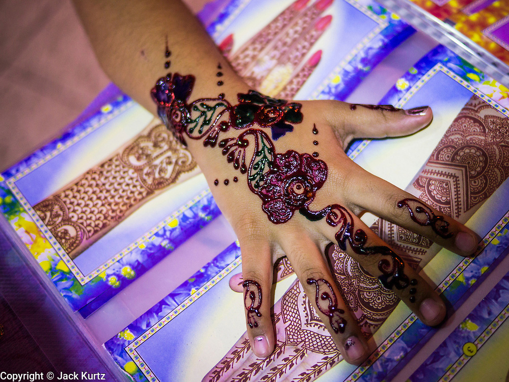 "20 DECEMBER 2012 - KUALA LUMPUR, MALAYSIA: The hand of a girl who received a henna tattoo on Jalan Tun Sambanthan, the main street in ""Brickfields,"" the Little India section of Kuala Lumpur, Malaysia. The ""Little India"" section of Kuala Lumpur is also known as ""Brickfields."" The area has recently been renovated and has emerged as a tourist draw. It's within walking distance of KL Stesen Sentral, the Kuala Lumpur central train station.    PHOTO BY JACK KURTZ"