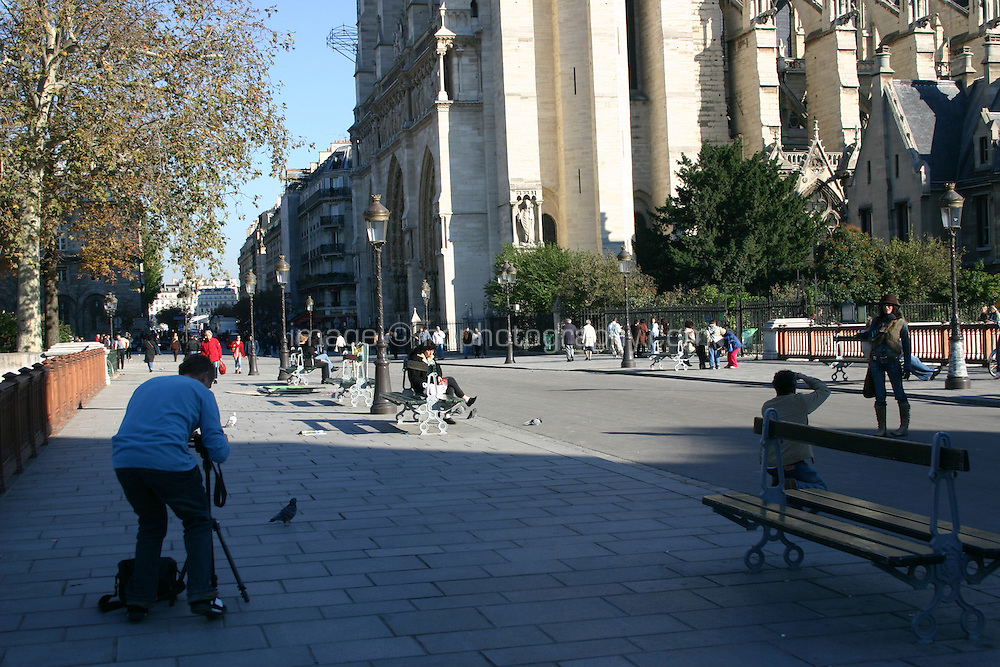 Photographer outside Notre-Dame, cathedral, Paris, France<br />