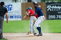 KELOWNA, BC - JULY 16:  Ryan Altenberger #1 of the Wenatchee Applesox is safe on second base after a tag by Richi Sede #4 of the Kelowna Falcons at Elks Stadium on July 16, 2019 in Kelowna, Canada. (Photo by Marissa Baecker/Shoot the Breeze)