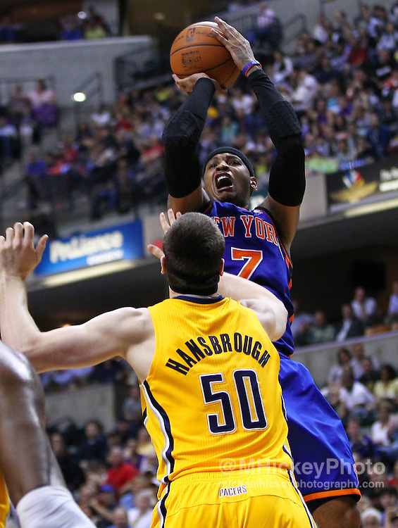 April 03, 2012; Indianapolis, IN, USA; New York Knicks small forward Carmelo Anthony (7) shoots against Indiana Pacers power forward Tyler Hansbrough (50) at Bankers Life Fieldhouse. Indiana defeated New York 112-104. Mandatory credit: Michael Hickey-US PRESSWIRE