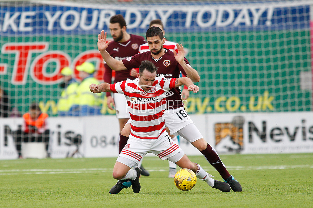 Hearts FC Defender Igor Rossi makes the tackle during the Ladbrokes Scottish Premiership match between Hamilton Academical FC and Heart of Midlothian at New Douglas Park, Hamilton, Scotland on 24 January 2016. Photo by Craig McAllister.