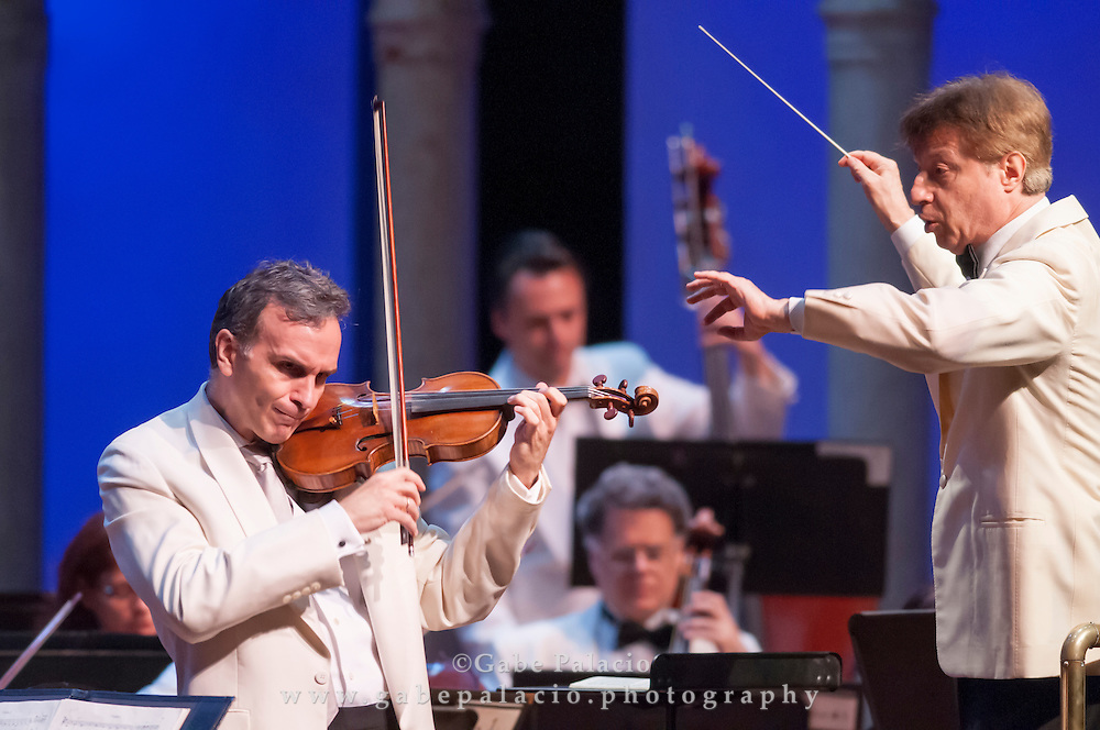 Gil Shaham, violin, performs Mendelssohn's Violin Concerto with Roberto Abbado, conductor, and the Orchestra of St. Lukes at the Opening Night of the 2012 International Music Festival at Caramoor in Katonah New York on June 23, 2012..photo by Gabe Palacio