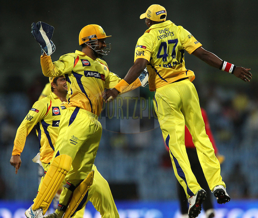 MS Dhoni and DJ Bravo celebrate the wicket of Colin Ingram during match 56 of the Indian Premier League ( IPL ) Season 4 between the Chennai Superkings and The Delhi Daredevils held at the MA Chidambaram Stadium in Chennai, Tamil Nadu, India on the 12th May 2011..Photo by Ron Gaunt/BCCI/SPORTZPICS