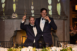 gay couple at their wedding making a toast