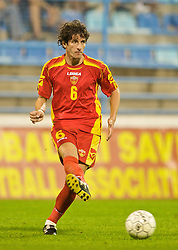 PODGORICA, MONTENEGRO - Wednesday, August 12, 2009: Montenegro's Mladen Kascelan in action against Wales during an international friendly match at the Gradski Stadion. (Photo by David Rawcliffe/Propaganda)