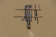 Log barge<br /> Demerara River<br /> GUYANA<br /> South America<br /> Longest river in Guyana