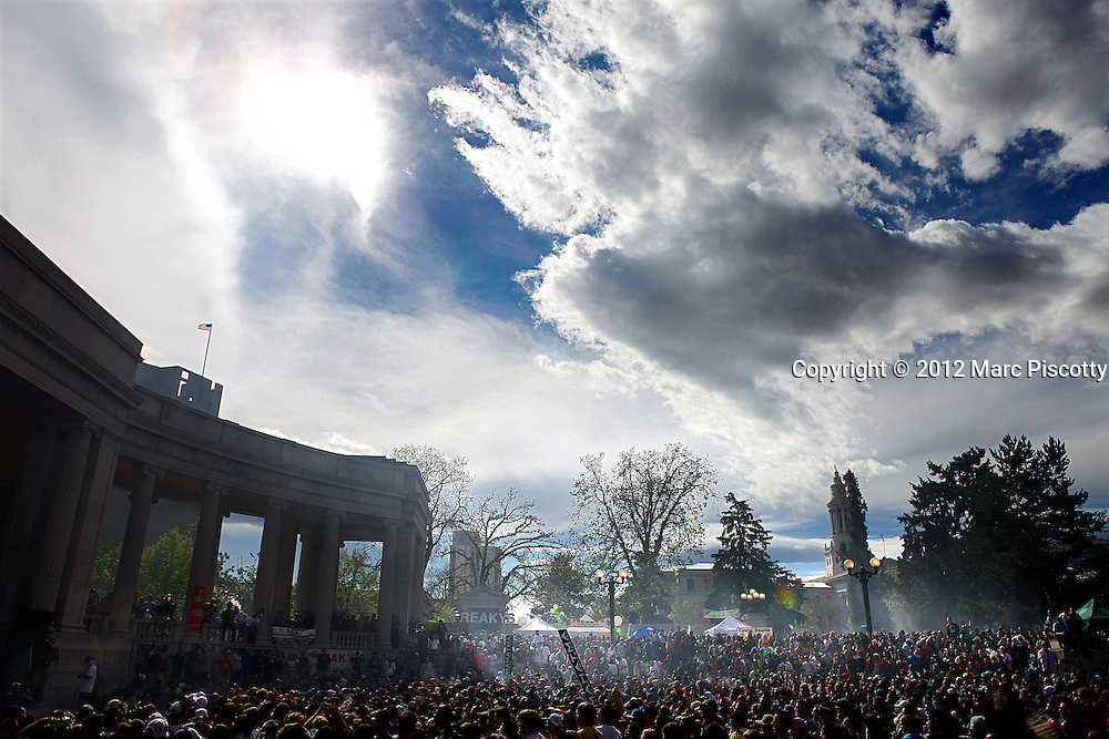 DENVER, CO - APRIL 20: A hazy cloud rises over the estimated 10,000 people that gathered in Civic Center Park in Denver, Colorado on April 20, 2012 to collectively smoke marijuana and to celebrate the state's Medicinal Marijuana laws and fight for legalization. On Nov. 6, Colorado may become the first state to legalize marijuana with the passing of Amendment 64, a controversial ballot initiative that would permit up to 1 ounce of possession for those 21 and older. (Photo by Marc Piscotty/ © 2012)