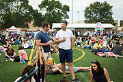 Attendees chat during the 4th annual Yum Yum Fest held at Breese Stevens Field, Sunday, August 6, 2017.