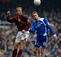 Photo: Daniel Hambury.<br />Arsenal v Cardiff City. The FA Cup. 07/01/2006.<br />Arsenal's Dennis Bergkamp (L) and Cardiff's Rhys Weston battle for the ball.