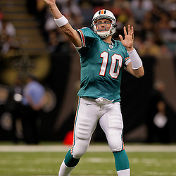 2009 September 03: Miami Dolphins quarterback Chad Pennington (10) throws during the first quarter of a preseason game between the Miami Dolphins and the New Orleans Saints at the Louisiana Superdome in New Orleans, Louisiana.