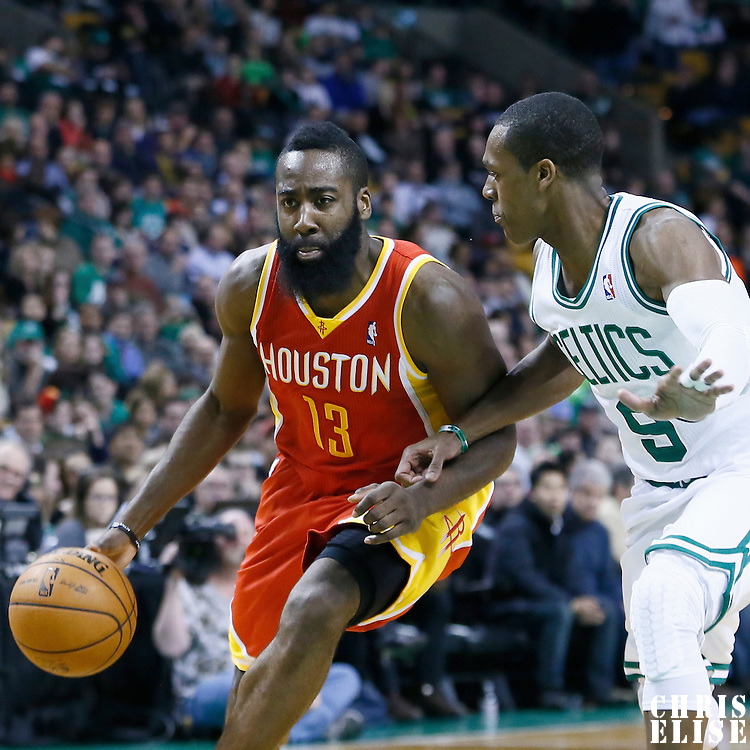 11 January 2013: Houston Rockets shooting guard James Harden (13) drives past Boston Celtics point guard Rajon Rondo (9) during the Boston Celtics 103-91 victory over the Houston Rockets at the TD Garden, Boston, Massachusetts, USA.
