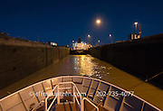 The bow of a ship as it transits the locks in the Panama Canal.