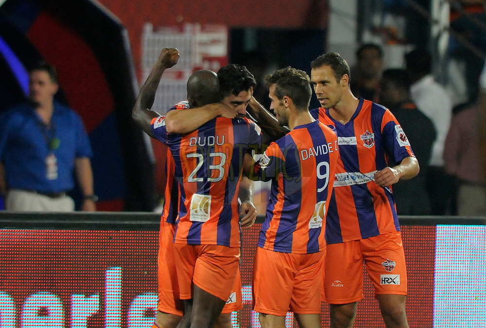 Kostas Katsouranis of FC Pune City celebrates a goal with teammates during match 44 of the Hero Indian Super League between FC Pune City and Atletico de Kolkata FC held at the Shree Shiv Chhatrapati Sports Complex Stadium, Pune, India on the 29th November 2014.<br /> <br /> Photo by:  Pal Pillai/ ISL/ SPORTZPICS