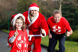 No fee for Repor: 18/12/2012 .Five year-old Rebecca Keenan from Cabinteely is pictured with Dublin footballer, Alan Brogan and former Irish athletics star, Eamonn Coghlan to launch this year's series of Christmas GOAL Mile events. Coghlan is holding his own GOAL Mile at Porterstown Park in Castleknock on St Stephen's Day at 11 a.m. A total of 100 GOAL Miles have been organised by members of the public around the country this Christmas. Dates, times and locations of all GOAL Miles are listed at www.goal.ie  Picture Andres Poveda