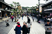 Tourists walk the streets near Dazaifu Shrine in Fukuoka, on Kyushu island in southern Japan.