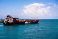 Port Reunion, Reunion -- January 20, 2018. A  cargo ship heads out to sea from Port Reunion. Editorial use only.