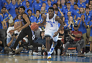 Nov 15, 2017; Los Angeles, CA, USA;UCLA Bruins guard Aaron Holiday (3) dribbles the ball against the Central Arkansas Bears during a NCAA basketball at Pauley Pavilion. UCLA defeated Central Arkansas 106-101 in overtime.