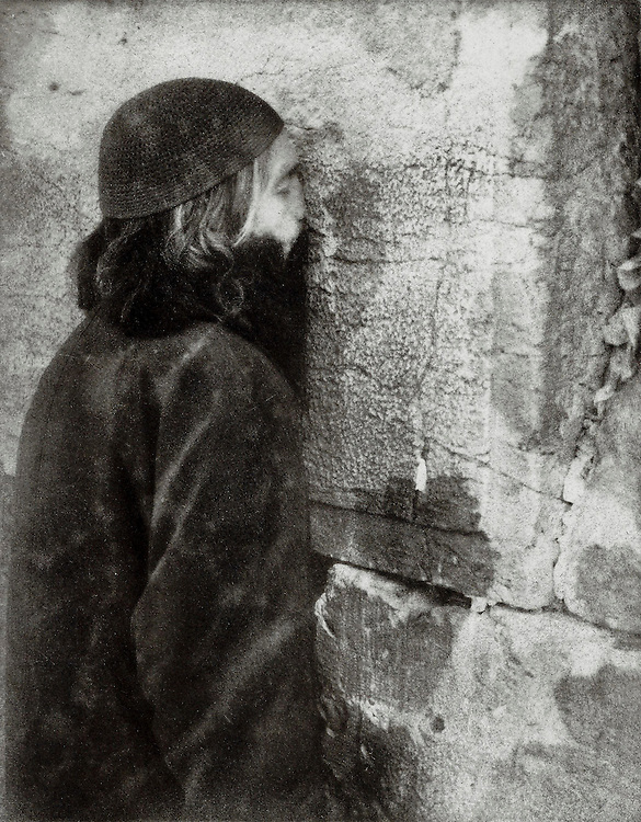 A man praying at the Western Wall in Jersualem. This image was created using the Bromoil process.