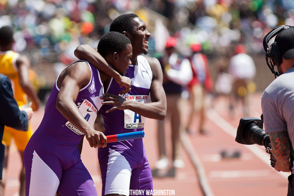 Keniel Grant(right) joins teammate Tevin-Lloyd Thompson of Kingston College (Jamaica) in celebrating a first place finish in the High School Boys' 4x100 Championship of America at the 119th Penn Relays on Saturday, April 27, 2013 in Philadelphia, PA.