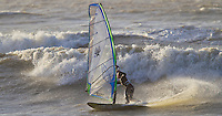 Windsurfers enjoying the gusty weather conditions along the south coast of England on the last Sunday in 2012