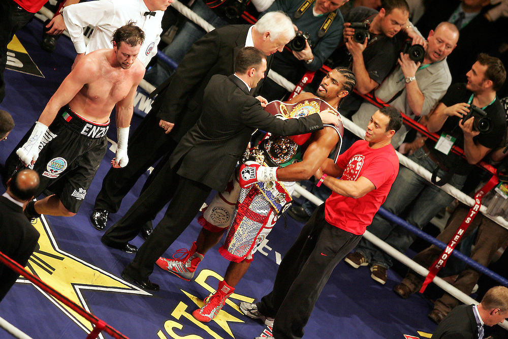 WBA and WBC champion David Haye is presented with the WBO belt after he knocked out WBO champion Enzo Maccarinelli in two rounds on Saturday night at the O2 Arena in London. 8th March 2008.