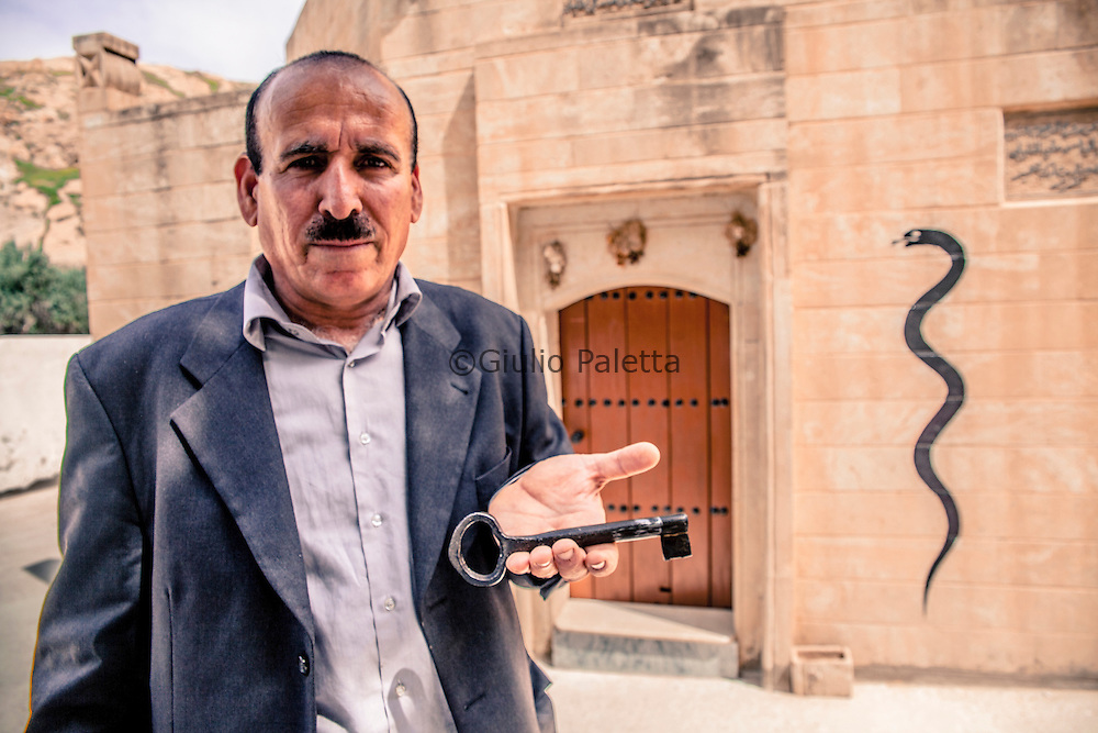 The servant of a Yazidi shrine in Bahzani with the key to open the holy door. It is almost impossible for a non Yazidi to be allowed to enter inside the shrine