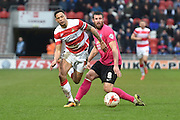 Nathan Tyson (14) of Doncaster Rovers and Michael Bostwick(8) of Peterborough United during the Sky Bet League 1 match between Doncaster Rovers and Peterborough United at the Keepmoat Stadium, Doncaster, England on 19 March 2016. Photo by Ian Lyall.