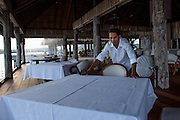 A waiter prepares for dinner service on Song Saa island.