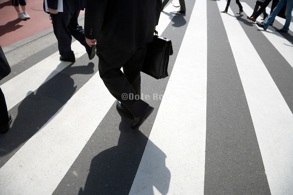 businesspeople crossing at a pedestrian crossing
