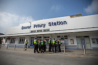 @Licensed to London News Pictures 02/04/2016. Dover, Kent. Members of the police gather outside Dover Priory rail station in Kent today in preparation of possible clashes between pro and anti refugees demonstrations. Photo credit: Manu Palomeque/LNP
