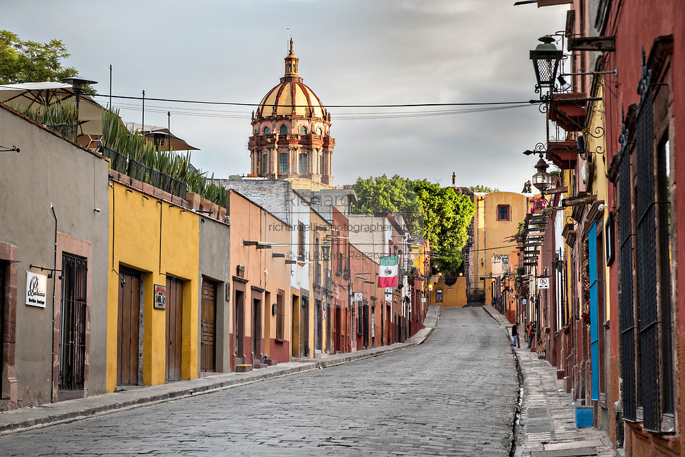 Dome of the Church of the Immaculate Conception also called the Nuns seen looking up Zacateros Street in the historic district of San Miguel de Allende, Mexico.