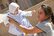 Uzbekistan, Khiva. Mother with baby.