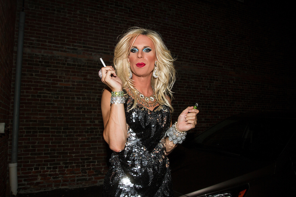 Drag Queen Katya smokes a cigarette after the shows outside of Jacques Cabaret in Bay Village neighborhood of Boston, MA USA on September 16, 2012.<br /> Jacques Cabaret (EST: 1931) is the oldest drag queen live cabaret in Boston, MA USA.