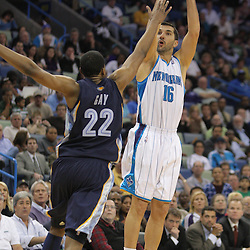 Jan 20, 2010; New Orleans, LA, USA; New Orleans Hornets forward Peja Stojakovic (16) shoots over Memphis Grizzlies forward Rudy Gay (22) during the second half at the New Orleans Arena. The Hornets defeated the Grizzlies 113-111. Mandatory Credit: Derick E. Hingle-US PRESSWIRE