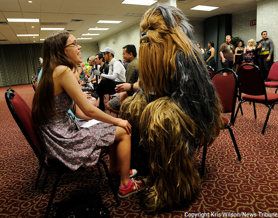 Kris Wilson/News Tribune<br /> Victoria Reiter, left, spends a couple of minutes chatting with a man dressed as Chewbacca during the Cosplacon 2013 Nerd Speed Date event at the Truman Hotel and Convention Center.