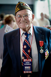 06 June 2014. The National WWII Museum, New Orleans, Lousiana. <br /> WWII veteran Pfc Warren Dufrene, 75th Division, 291st Infrantry is honored with the French Legion of Honor medal.<br /> Photo; Charlie Varley/varleypix.com