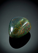 Cutout of a Heliotrope, or bloodstone gemstone on black background