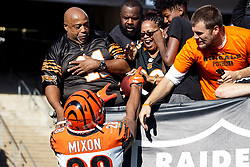 OAKLAND, CA - NOVEMBER 17: Running back Joe Mixon #28 of the Cincinnati Bengals hands his mother Alisa Mixon a football after scoring a touchdown against the Oakland Raiders during the first quarter at RingCentral Coliseum on November 17, 2019 in Oakland, California. The Oakland Raiders defeated the Cincinnati Bengals 17-10. (Photo by Jason O. Watson/Getty Images) *** Local Caption *** Joe Mixon; Alisa Mixon