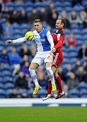 Bristol City's Louis Carey battles for the high ball with Blackburn Rovers' Ruben Rochina - Photo mandatory by-line: Joe Meredith/JMP  - Tel: Mobile:07966 386802 05/01/2013 - Blackburn Rovers v Bristol City - SPORT - FOOTBALL - FA Cup -  BLACKBURN - EWOOD PARK -